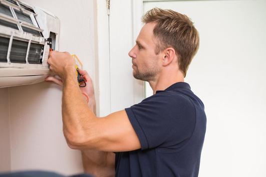 repairman, repairing a cooling system, miami